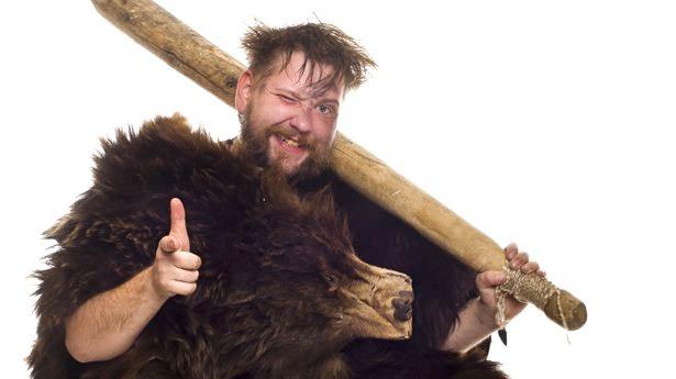 Caveman-in-bear-skin-via-Shutterstock