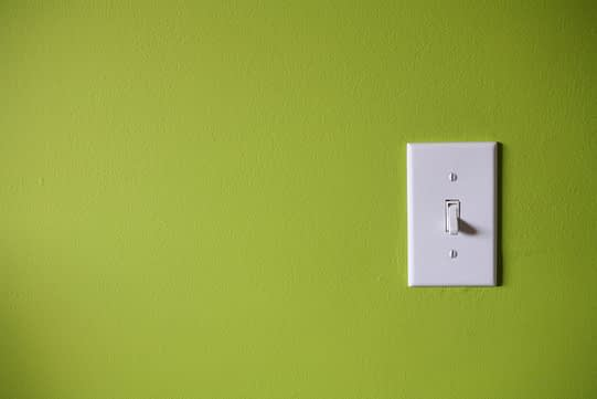 light-switch-in-front-of-green-background-91448627-57fe9fe35f9b5805c271843c