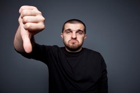Man-giving-thumb-down